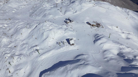 Aerial - High angle view of people skiing at ski resort Live Action