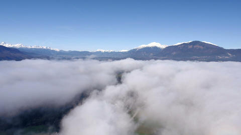 Aerial - Snowy Alps above the clouds Footage
