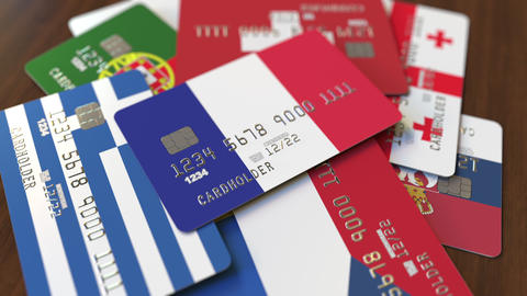 Many credit cards with different flags, emphasized bank card with flag of France Footage