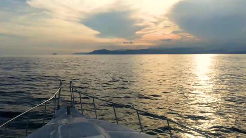 Sailing ship on the sea from Gili Island to Bali island during beautiful sunset Footage