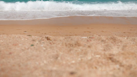 4k slow motion footage of rolling blue sea waves on the golden sand beach at Footage