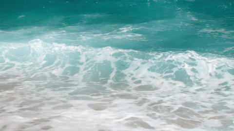4k slow motion video of powerful turquoise sea waves breaking on shoreline at Footage
