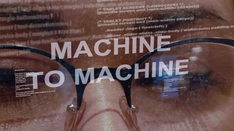 Machine to machine text on background of female developer Live Action