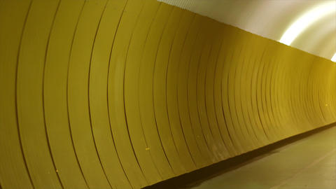 4K Yellow walls. Abstract, decorative tunnel walls which is yellow. Light is end of the road Live Action