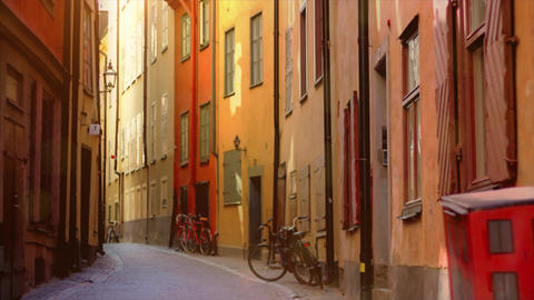 Colorful, traditional houses in tight street. Bike, sunshine and Nostalgic Italian houses Live Action