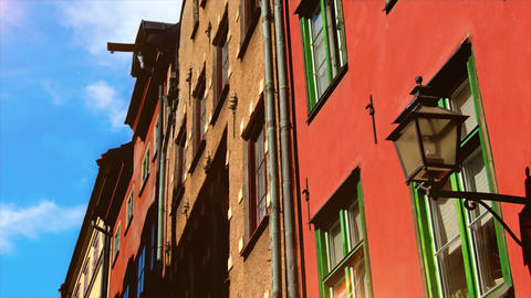 Colorful, traditional Italian houses and street with blue sky street. Retro House windows and clouds Live Action