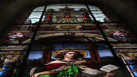 Stained Glass in church. Christianism, religion, holy father and Jesus Live Action