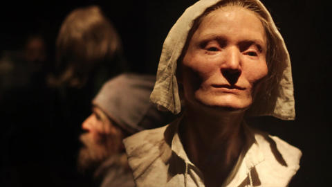A wax sculpture of old, Nordic woman. Worker woman's sculpture is realistic, old Scandinavian woman Live Action