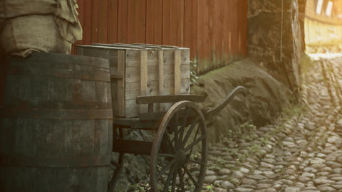 Old style, trolley and barrels traditional. Pavement sidewalks, vintage, retro style historical farm Live Action