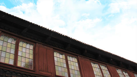 Stockholm city's traditional wooden building with glass, with wooden roof and blue sky Footage