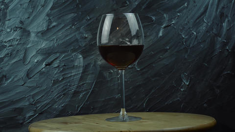 Pouring red wine of bottle. Isolated beverage, alcohol, winery Live Action