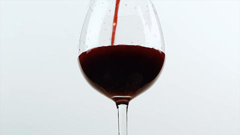 Pouring red wine of bottle. Isolated beverage, alcohol, winery footage on white background Live Action