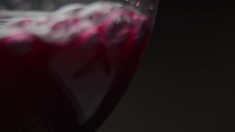 Pouring red wine of bottle. Isolated beverage, alcohol, winery footage on black background Live Action