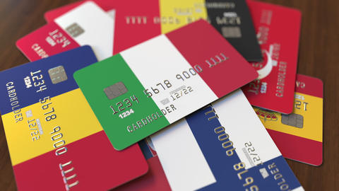 Many credit cards with different flags, emphasized bank card with flag of Italy Footage