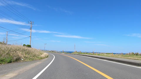 Driving picture. Slow curve near the sea Footage