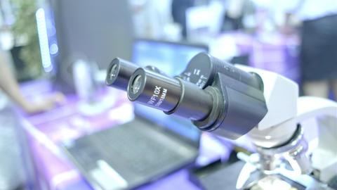 A boy chemist looks into a microscope. Education science in school. Modern Footage