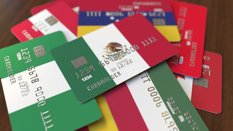 Many credit cards with different flags, emphasized bank card with flag of Mexico Footage