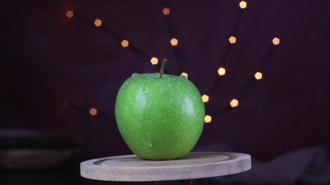 Green apple is rotating in the kitchen's platform. Healthy, vitamin footage, green, nutrition Live Action