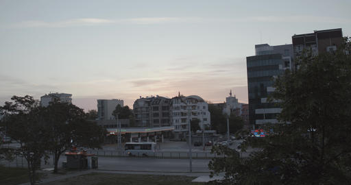 City bus passing through boulevard at sunrise in the morning Archivo