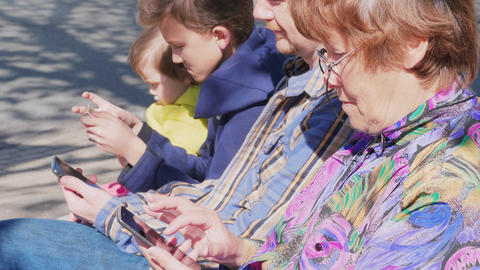 Internet addiction, adults and children with mobiles outdoor Footage