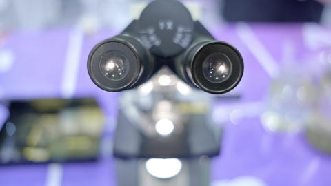 look into the microscope with a gradual zooming Live Action