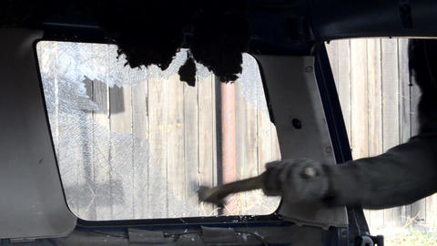 Man breaks the glass of the car Live Action