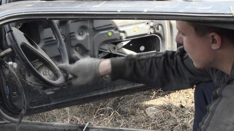 Man steers a broken car Live Action