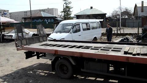 Tow truck pulls a broken car Live Action