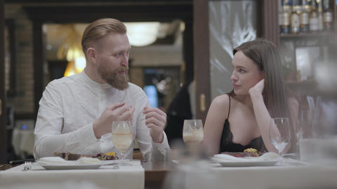 Portrait of a beautiful young couple dining in a cafe or restaurant. Partners Footage