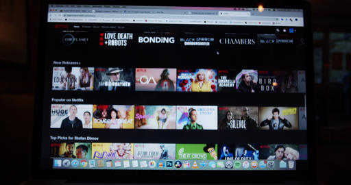 User watching movies and tv shows on streaming platform Netflix from laptop Footage