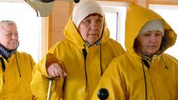 Group senior woman in yellow waterproof jacket on passengers ship board. Mature Footage