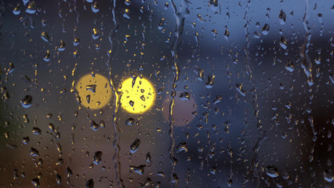 Raindrops On A Window On A Rainy Day With Moving Bokeh Lights 4K GIF