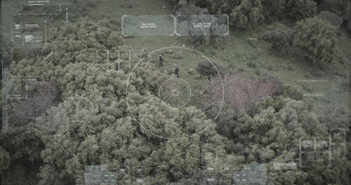 Surveillance drone view of soldiers walking through a forest with hud graphics Live Action