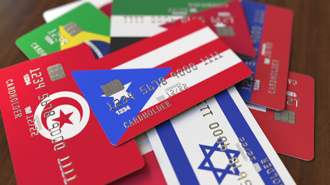 Many credit cards with different flags, emphasized bank card with flag of Puerto Footage