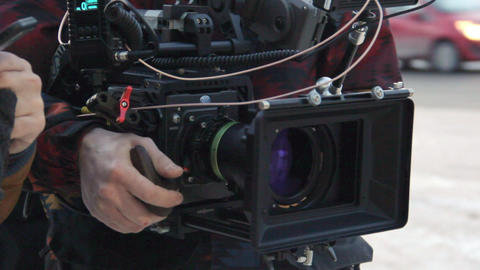 cameraman holds shooting equipment at set close view Footage