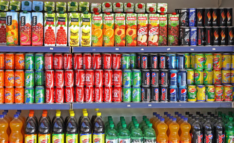 Bottles of soft drinks on a market shelves Photo