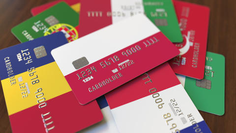 Many credit cards with different flags, emphasized bank card with flag of Poland Live Action