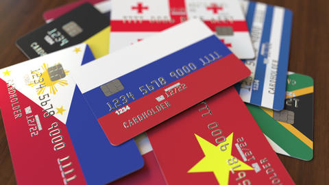 Many credit cards with different flags, emphasized bank card with flag of Russia Live Action