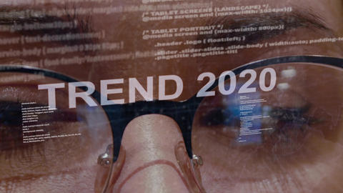 Trend 2020 text on background of female developer Live Action