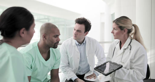 Medical professionals discussing results in a hospital Live Action