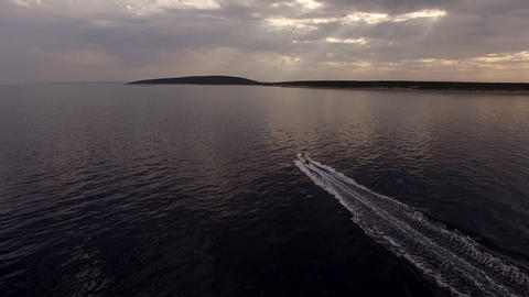 Aerial - Rear view of a speed boat ride Live Action