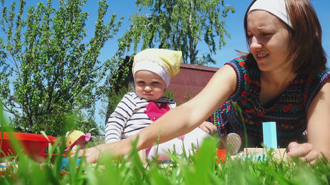 Mother and daughter playing on the lawn Footage