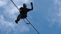 Highline walker in blue sky, Prohodna Cave, Bulgaria Footage