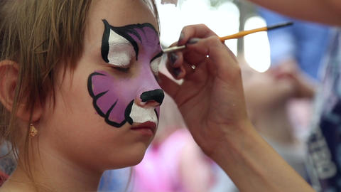 The artist paints face painting Footage