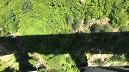 Klisura Bridge, Bulgaria - June 11, 2016: Bungee jumpers 230 feet bridge jump Footage