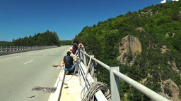 Klisura Bridge, Bulgaria - June 11, 2016: Bungee jumpers checking the gear prepa Footage