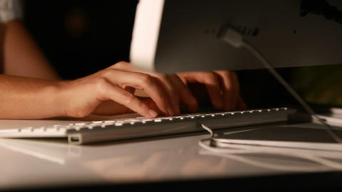 Businesswoman using computer at night Live Action