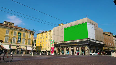 Town square with advertising billboards, one of which in green screen Footage