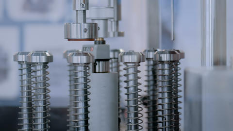 Automatic ampoule filling and sealing equipment machine at pharmacy factory Footage