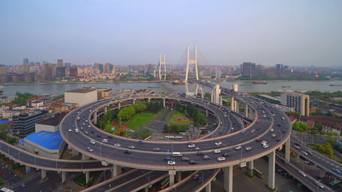 Aerial view of Nanpu Bridge, Shanghai Downtown, China. Financial district and business centers in Live Action